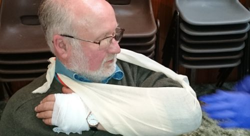 How to treat a patient that is bleeding and hold the arm up in a sling
