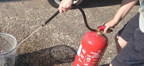 Fire Extinguisher in use
